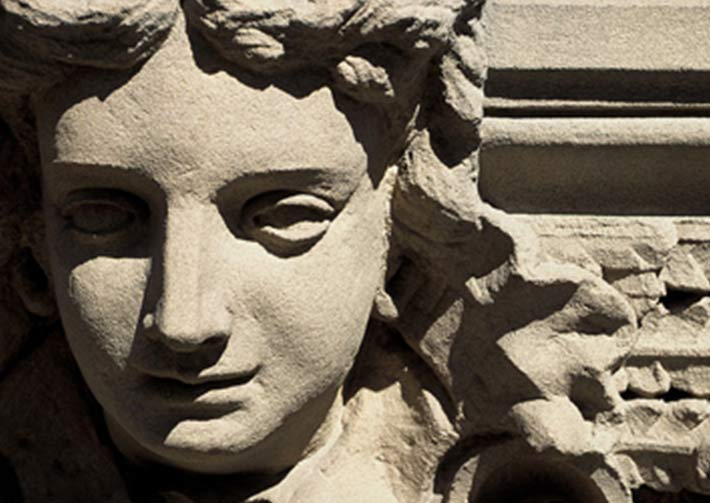 A close-up of a carved stone face at Sydney Hospital.