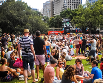 People enjoy music by DJ at Hyde park for Sydney festival in Sydney, Australia