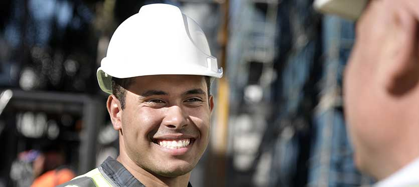 building certification as a career main in hard hat on job site
