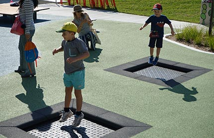 children jump on mini trampolines at a new park