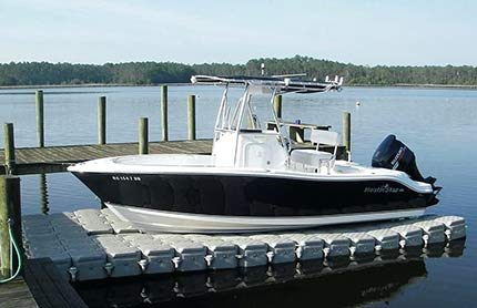 A large motor boat on a boat ramp.