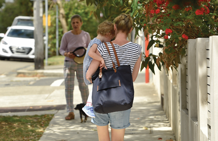 Mother with her child walking down the street in St Leonards, North Sydney, NSW.