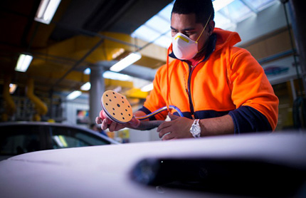 western sydney employment area factory worker sanding