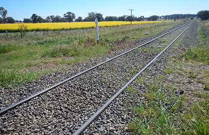 Landscape view of fields near train tracks, Inland Rail project. Photo by Australian Rail Track Corporation