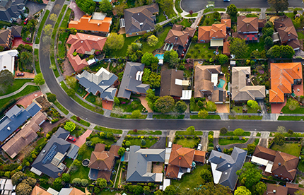 Aerial view of homes by a road