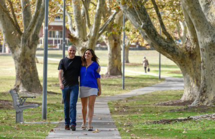 A couple walking through Arncliffe park, NSW.  Photo by: Adam Hollingworth/DPIE