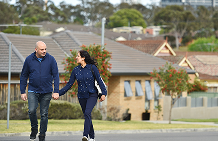 Couple walking in a residential area in Westmead, Western Sydney NSW. Photo by DPIE/ Adam Hollingworth
