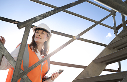 A female building certifier inspects scaffolding on a building site. Photo by: NSW Department of Planning, Industry and Environment / Christopher Walters