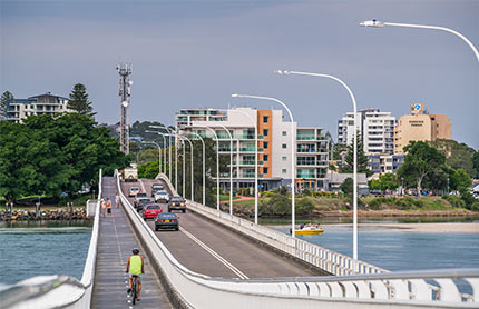 Cars and cyclist crossing bridge in Forster