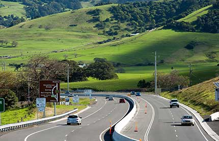 Gerringong Road with grassy hills behind