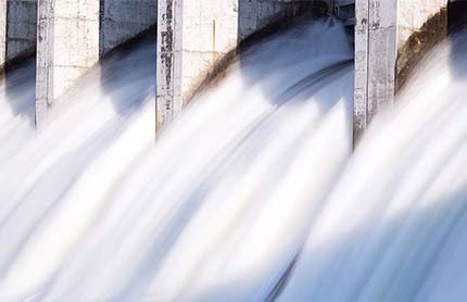 Water rushing out of hydro dam stock photo. Photo credit: iStock.com / Kat72